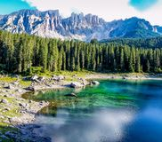 Colorful lake with the dolommites mountains stock photo