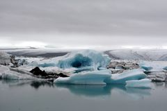 Colorful lake with icebergs moving into the ocean in Iceland Stock Images