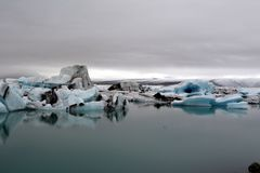 Colorful lake with icebergs moving into the ocean in Iceland Stock Photos
