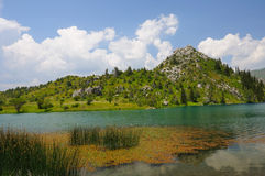 Colorful lake with mountains, sky and clouds Royalty Free Stock Photos