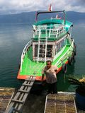 Colorful Lake Toba water taxi. Colorful water taxi on the Indonesian Lake Toba. Ferries cross many times daily between Sumatra`s mainland and Samosir island, a royalty free stock photos