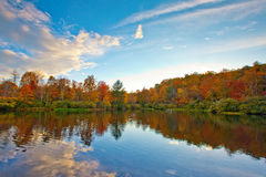 Colorful lake with trees around bank Royalty Free Stock Photos