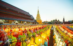 Colorful Lamp and lantern in Loi Krathong Wat Phra That Haripunchai ,Lamphun ,Thailand. Gold pagoda and lantern hung up on the rail to the prosperity in loy royalty free stock images