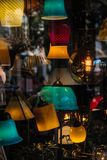Colorful lamps in the shop window and a reflection on it royalty free stock image