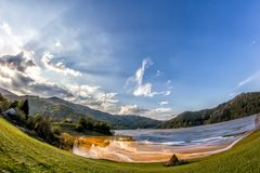 Colorful landscape of a flooded church in toxic polluted lake due to copper mining. Geamana Village, Sesii Valley, Romania Royalty Free Stock Images