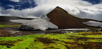 Colorful landscape in Iceland. Moss, ice and clouds Stock Images