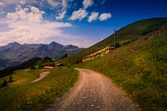 Colorful landscape in the Jungfrau region with the mountain train from Lauterbrunnen to Kleine Scheidegg. Wengen, Bernese Alps, Sw Stock Images