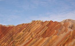 Colorful landscape of rainbow mountains and blue sky. royalty free stock photo