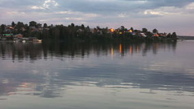 Colorful landscape at sunset. The reflection of the lights in the water. stock video footage