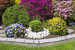 Colorful landscaped flower garden Royalty Free Stock Photo