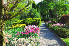 Colorful landscaped formal garden. Colorful landscaped formal garden in Spring Royalty Free Stock Image