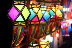 Colorful Lanterns. Traditionally made colorful lanterns fluttering in the winds on the Indian streetside decoration, on the occasion of Diwali festival in India Stock Photo