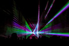 Colorful laser show nightlife club stage with party people crowd. Luxury entertainment with audience silhouettes in nightclub event, festival or New Year`s Eve stock photo