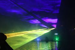 Colorful lasershow at the ring canal Zuidplaspolder during the Vlootschouw event in Nieuwerkerk aan den IJssel. royalty free stock photo