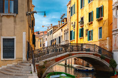 Colorful lateral canal and bridge in Venice, Italy Royalty Free Stock Images