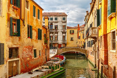 Colorful lateral canal and bridge in Venice, Italy Royalty Free Stock Photography