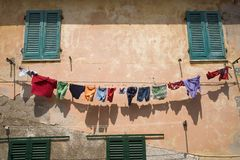 Colorful laundry hanging on clothing line in Portoferraio, Province of Livorno, on the island of Elba in the Tuscan Archipelago of Stock Photo