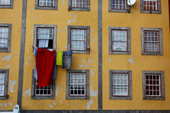 Colorful laundry hanging out apartment window Royalty Free Stock Photo