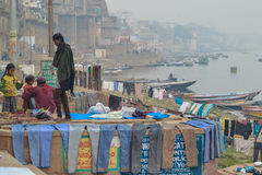 Colorful Laundry Out to Dry, Varanasi, India. Children Walk where Laundry, mostly pants/trousers Hangs in any Free Space to Dry, Varanasi (Benares) India Stock Photography