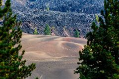 Colorful lava beds and cinder cones left by volcano make bleak landscape in Lassen National Volcanic Park Stock Photography