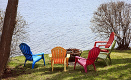 Colorful lawn chairs Stock Images