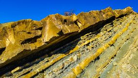 Colorful layers of the earth`s crust, yeiiow stones stock photography