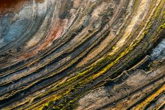 Colorful layers of quarry side in Kryvyi Rih, Ukraine. Aerial shot of huge open pit at sunset Royalty Free Stock Photography