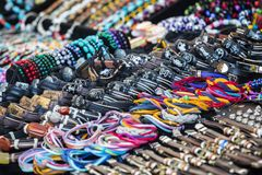 Colorful leather bracelets, beads, accessories and souvenirs. Detail view of many various colorful leather bracelets with zodiacal signs, beads, accessories and royalty free stock photos