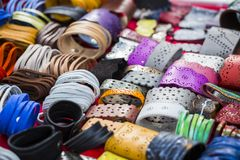Colorful leather bracelets. Detail view of many various colorful leather bracelets, accessories and souvenirs royalty free stock images