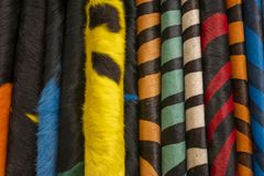 Colorful leather carpets in a San Telmo neighborhood business. Buenos Aires, Argentina, 9 May 2019. Natural cowhide rugs with hair dyed fantasy colors for sale royalty free stock photography