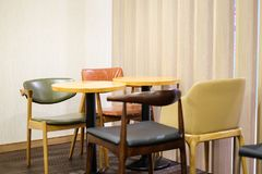 Colorful leather chair and brown wooden table set for breakfast. Colorful leather chair and brown wooden table set for breakfast, lunch and dinner - interior Royalty Free Stock Photo