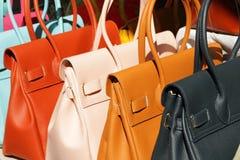 Colorful leather handbags Stock Photos