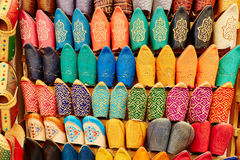 Colorful leather slippers in Marrakech, Morocco. Colorful handmade leather slippers (babouches) on a market in Marrakech, Morocco Royalty Free Stock Photography