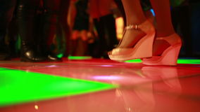 Colorful led dance floor with people dancing. stock footage