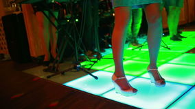 Colorful led dance floor with people dancing. stock video