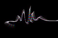 Colorful LED track, in form of waves on black. Background vector illustration