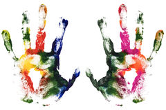 Colorful left and right hands print of paint. Colorful left and right hands print. Close up of colored gouache hands print on white background stock images
