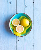 Colorful Lemon fruits over a light blue painted wood table Royalty Free Stock Photography