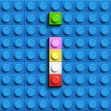 Colorful letter I from building lego bricks on blue lego background. Lego letter M. 3D design Royalty Free Stock Photo