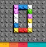 Colorful letter O from building lego bricks on gray lego background. Lego letter M. 3D design Stock Photo