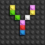 Colorful letter y from building lego bricks on black lego background. Lego letter M. 3D design Royalty Free Stock Photos