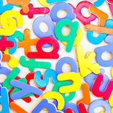 Colorful letters. Colorful play letters on white surface Royalty Free Stock Photo