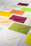 Colorful letters. Side view of colorful stationery - envelopes - green, red, yellow, pink and orange - vertical view Royalty Free Stock Photos