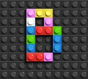 Colorful letters B of alphabet from building lego bricks on black lego brick background. lego background. 3d letters. 3D design Stock Photography