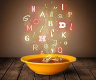 Colorful letters coming out of home cook soup bowl Stock Image