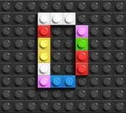 Colorful letters D of alphabet from building lego bricks on black lego brick background. lego background. 3d letters. 3D design Royalty Free Stock Photos