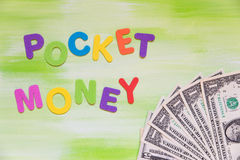 Colorful letters with dollars, pocket money Stock Image