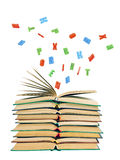 Colorful letters flying out of an open book Stock Photo