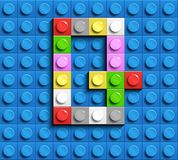 Colorful letters G of alphabet from building lego bricks on blue lego brick background. blue lego background. 3d letters C. Realis. Tic letters. 3D design Royalty Free Stock Photography