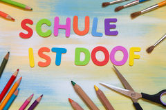 Colorful letters, german text, concept school and education. Colorful lettes, german text schule ist doof, which means dumb or silly school Stock Photography